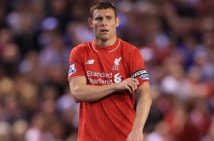 17th August 2015 - Barclays Premier League - Liverpool v Bournemouth - James Milner of Liverpool adjusts the captain's armband - Photo: Simon Stacpoole / Offside.